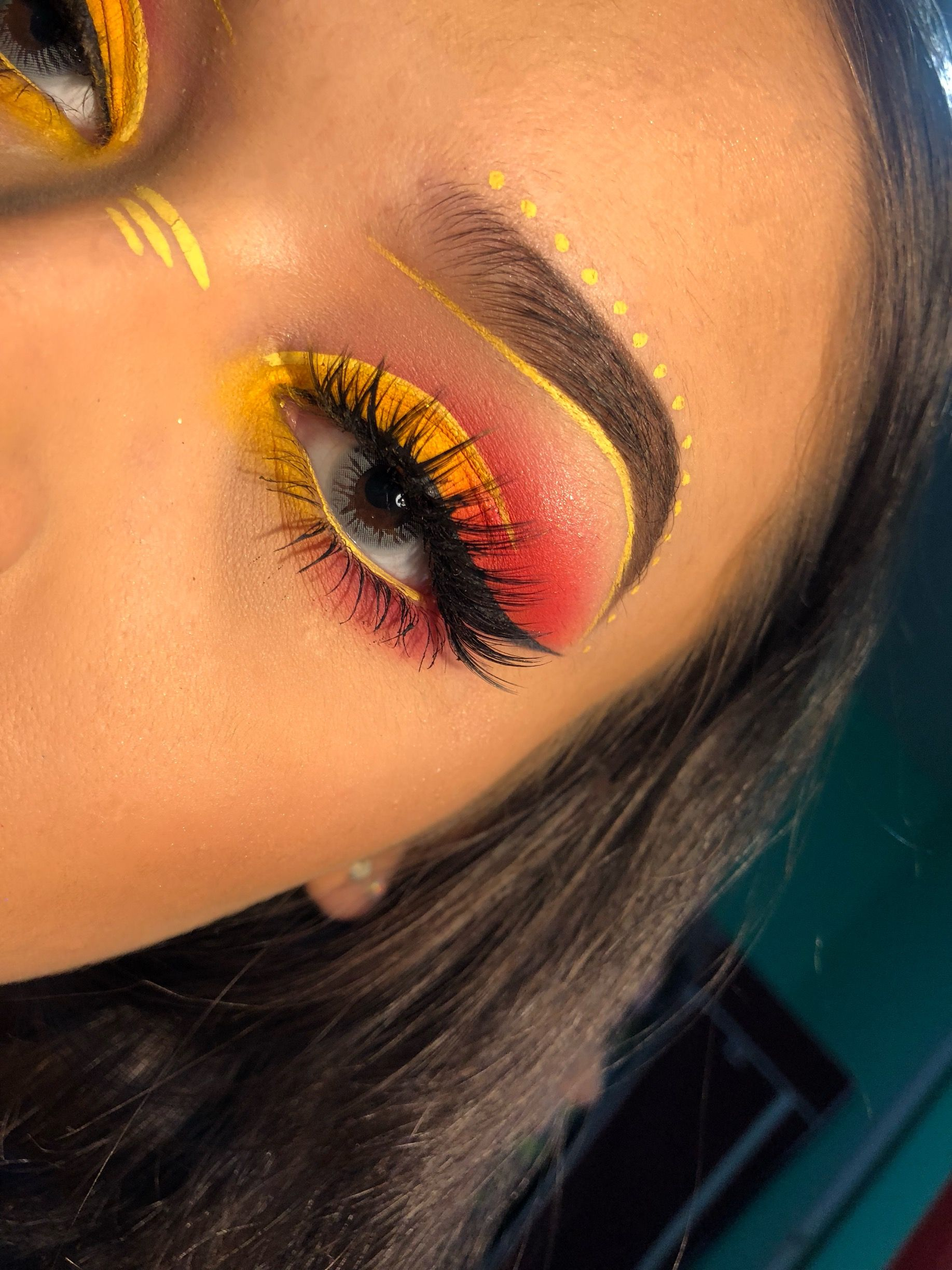 Yellow and red coachella makeup yellow and red smokey