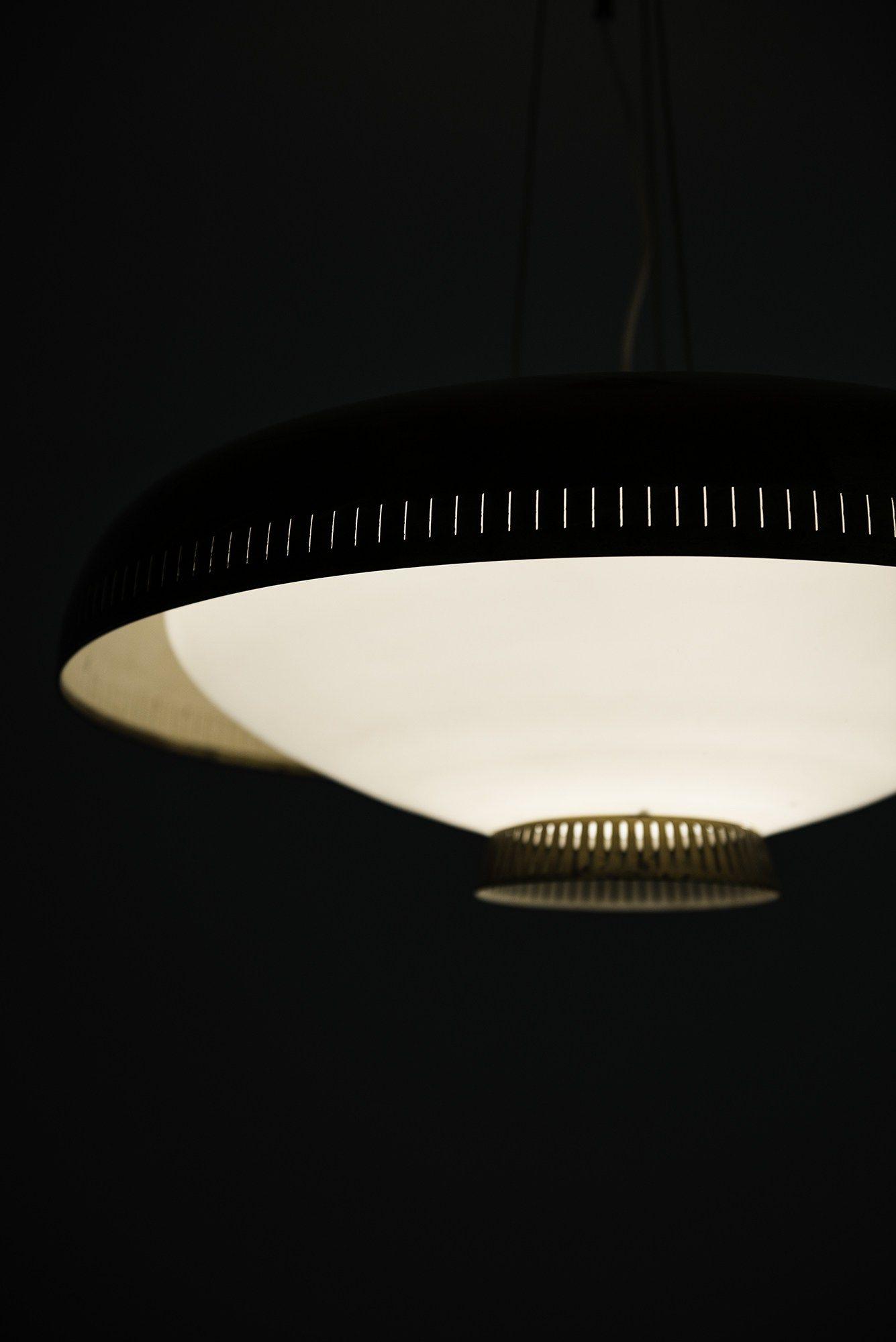 Asea ceiling lamp in opaline glass at studio schalling lighting