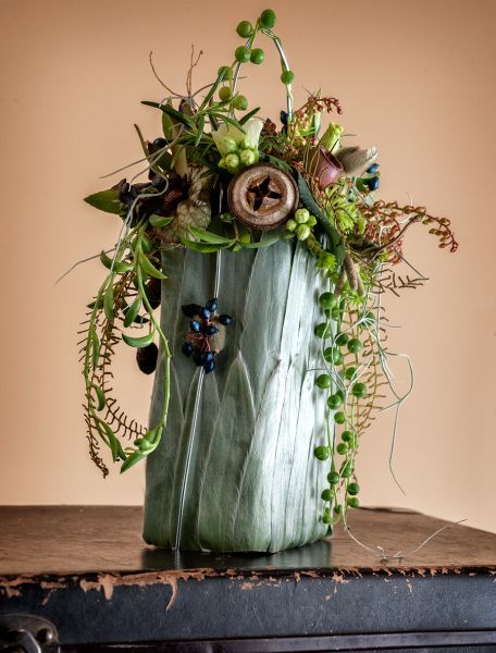 Photo of botanical  purse centerpiece www.tablescapesby… www.facebook.com/…
