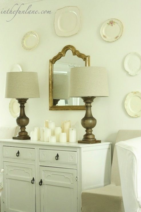 dining rooms - wall plates white vintage buffet wood lamps gray linen slipcover chairs Shabby chic dining room with wood lamps, gold mirror,