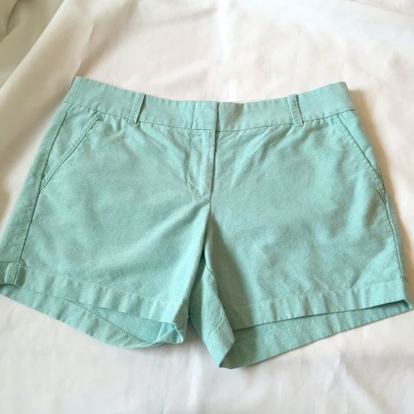 J. Crew Blue Green Broken In Cotton Chino Shorts 8 They're in excellent condition. The material is structured yet lightweight and comfortable. The fabric content is cotton. 9 inch rise, 12.5 inches long, 4.5 inch inseam. The color is seafoam. It's a light blue green shade with hints of gray. J. Crew Shorts