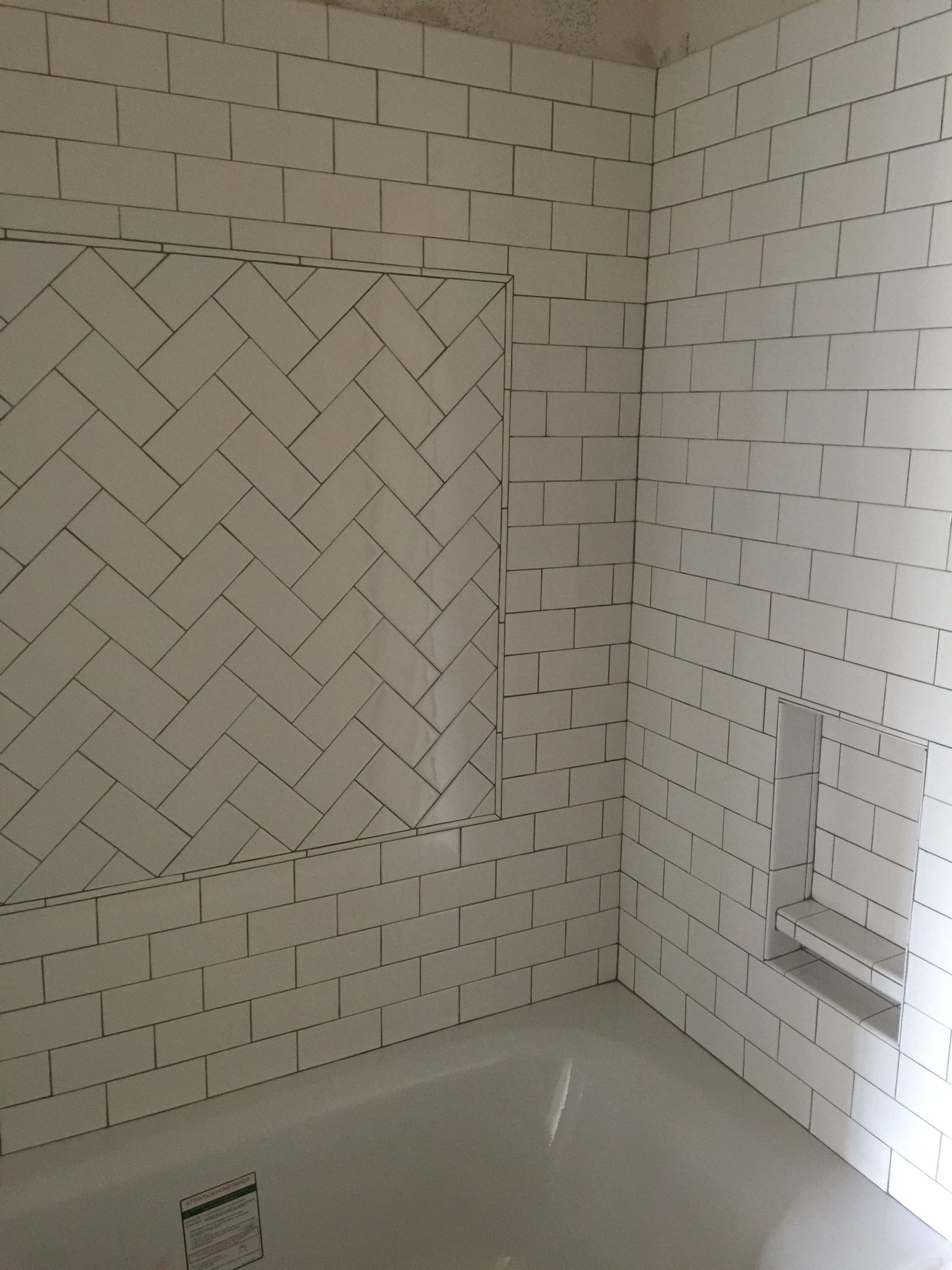 my kids new tub and tile surround. white subway tiles with oyster