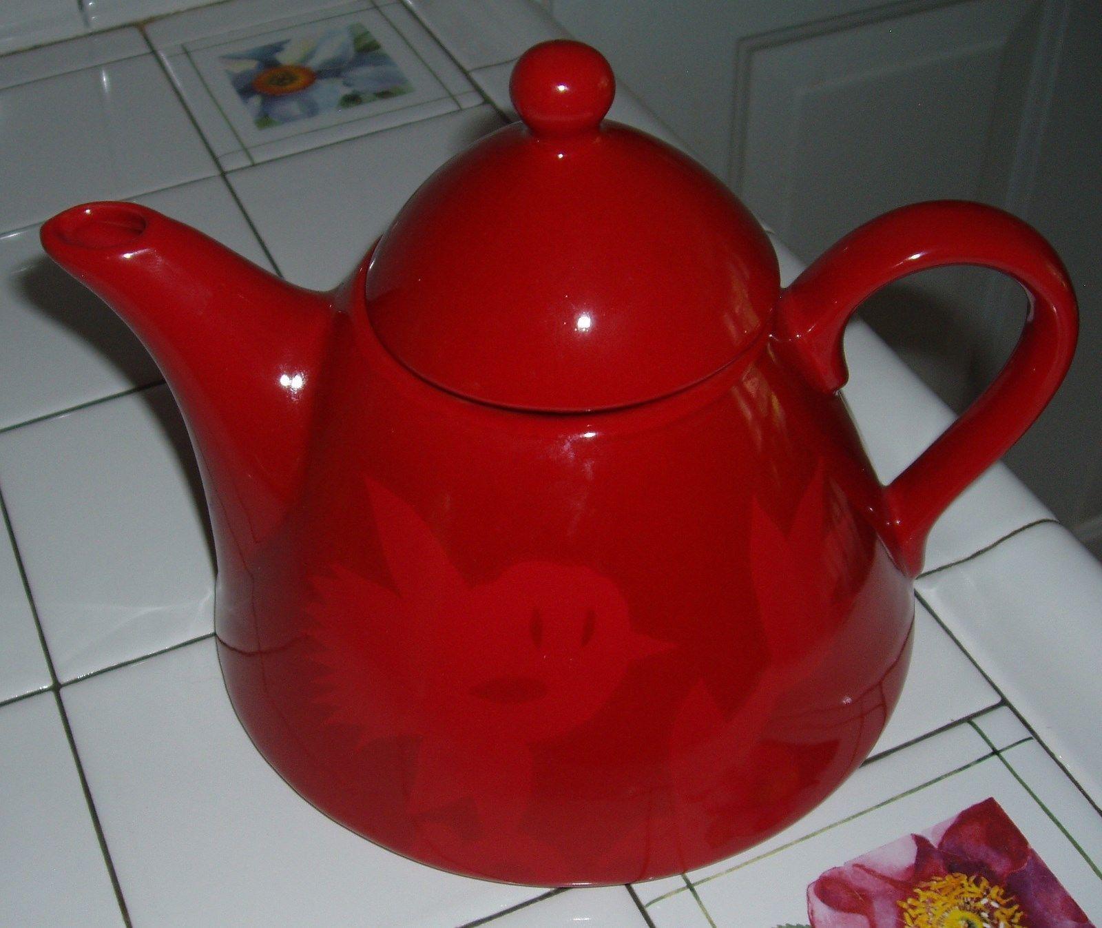 unique red teapot with bird caricature tulip flower design stoneware