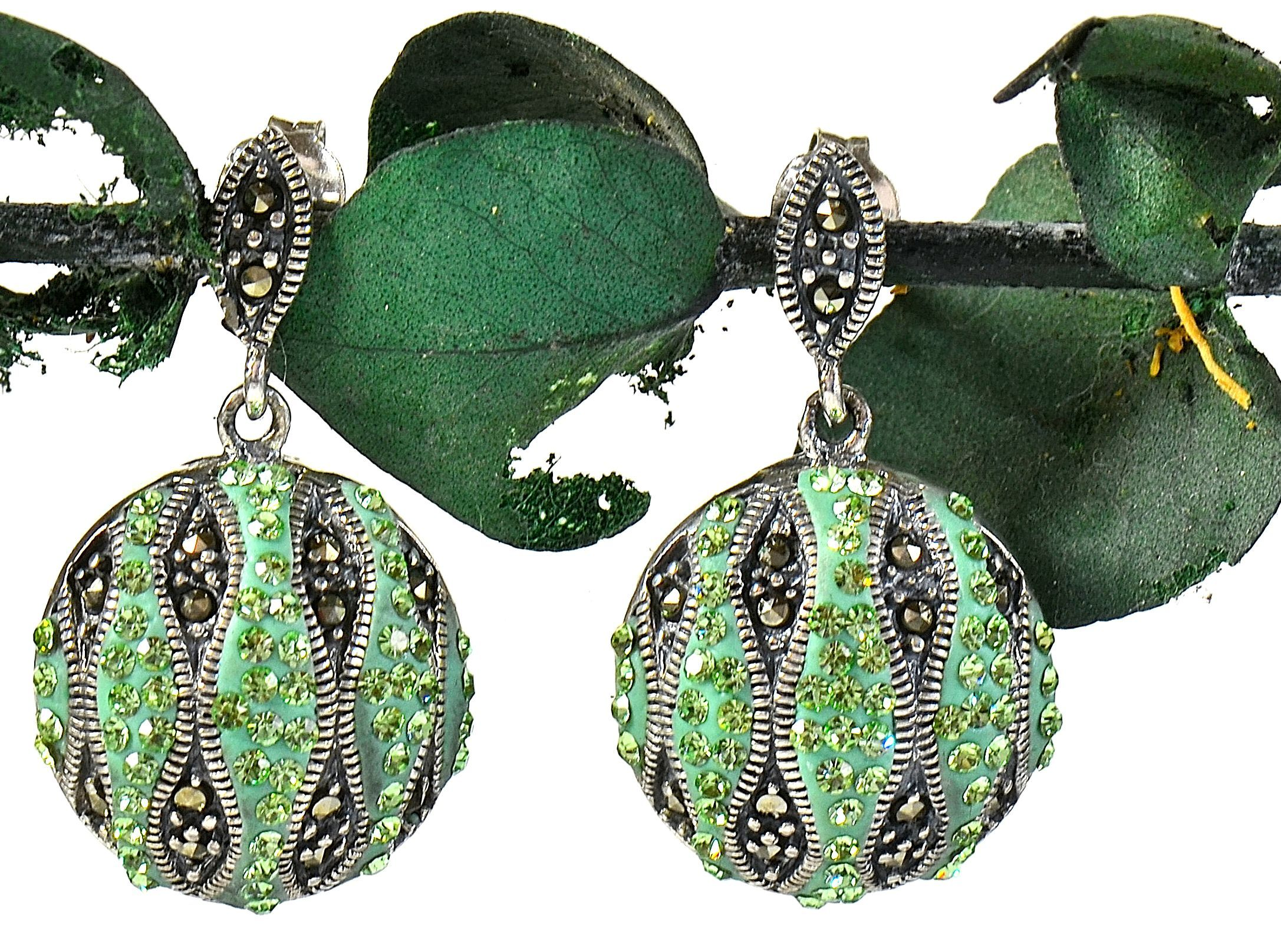 Soleil Green Peridot and Crystal Earrings - green peridot and crystal stripes alternate with marcasite stripes. Silver cording accents separate the colors and outline the curved shape of the stripes. http://simplybeautiful2012.com/soleil-green-peridot-and-crystal-earrings.html#