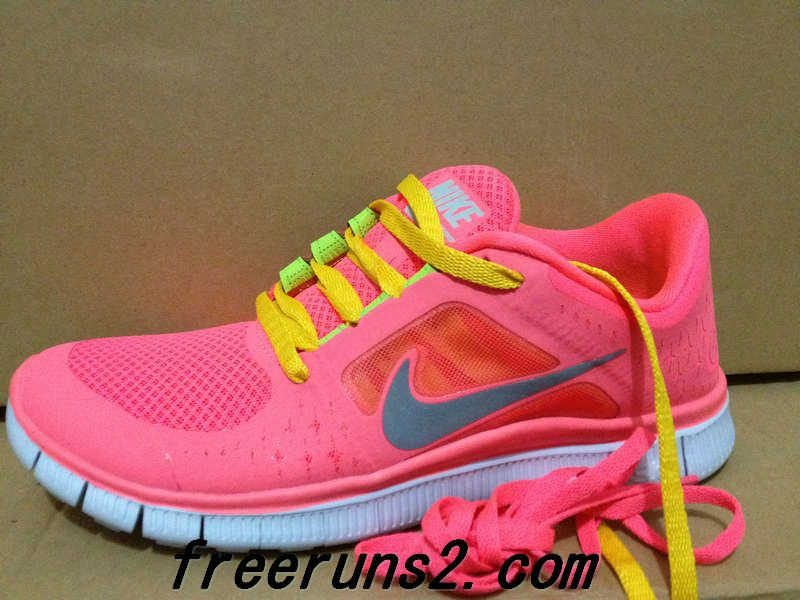nike free run neon pink with blue laces red