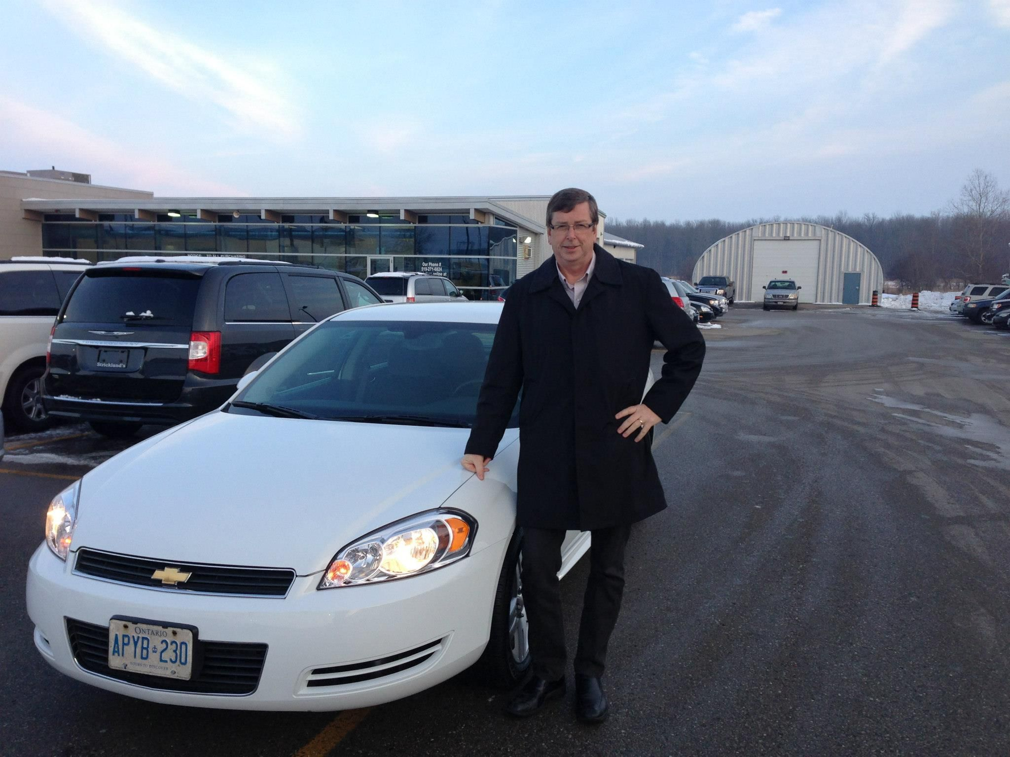 Doug strikes a pose beside his 2011 Chevrolet Impala from