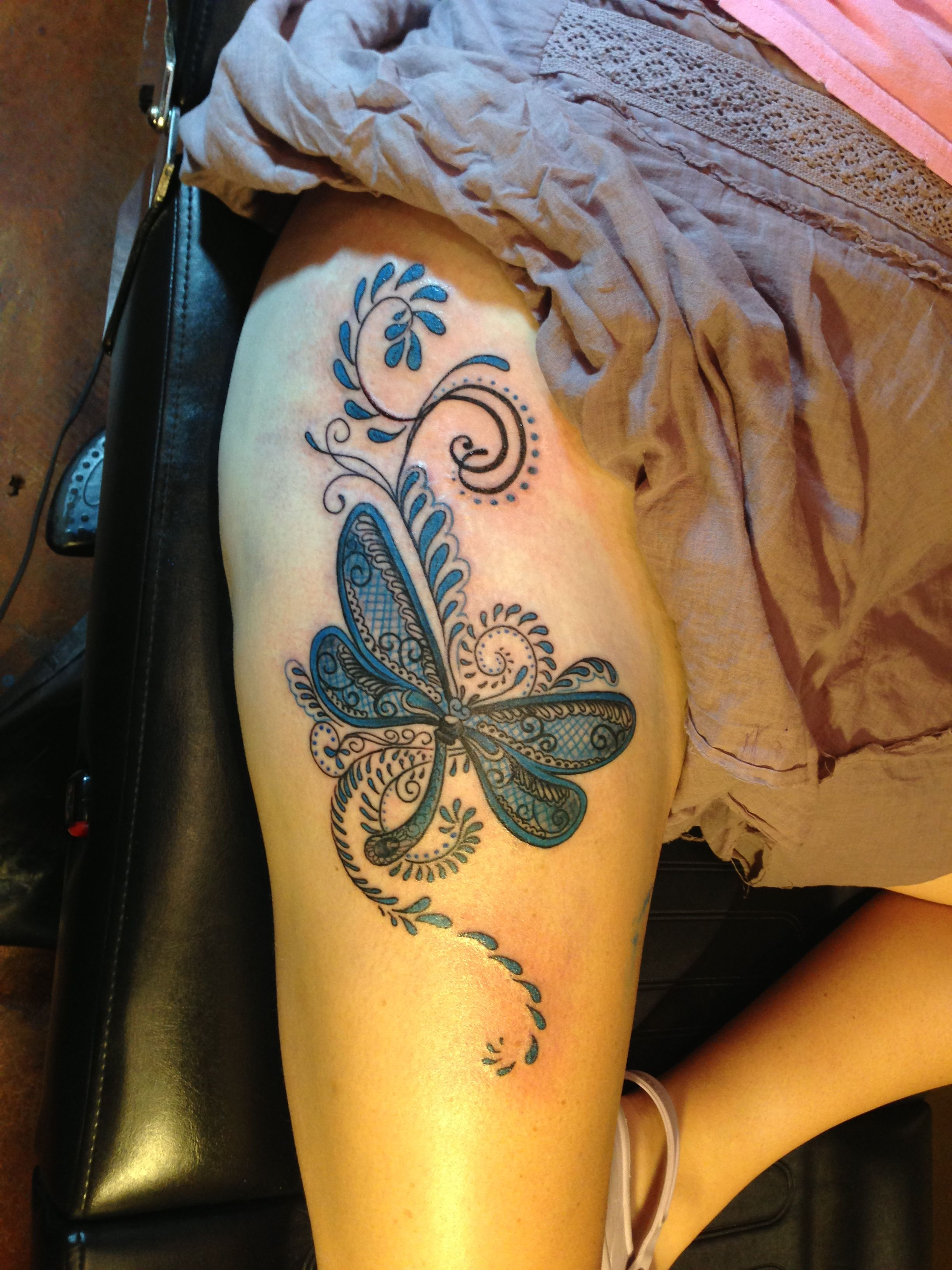Dragonfly thigh tattoo by Cara Hanson Dragonfly tattoo