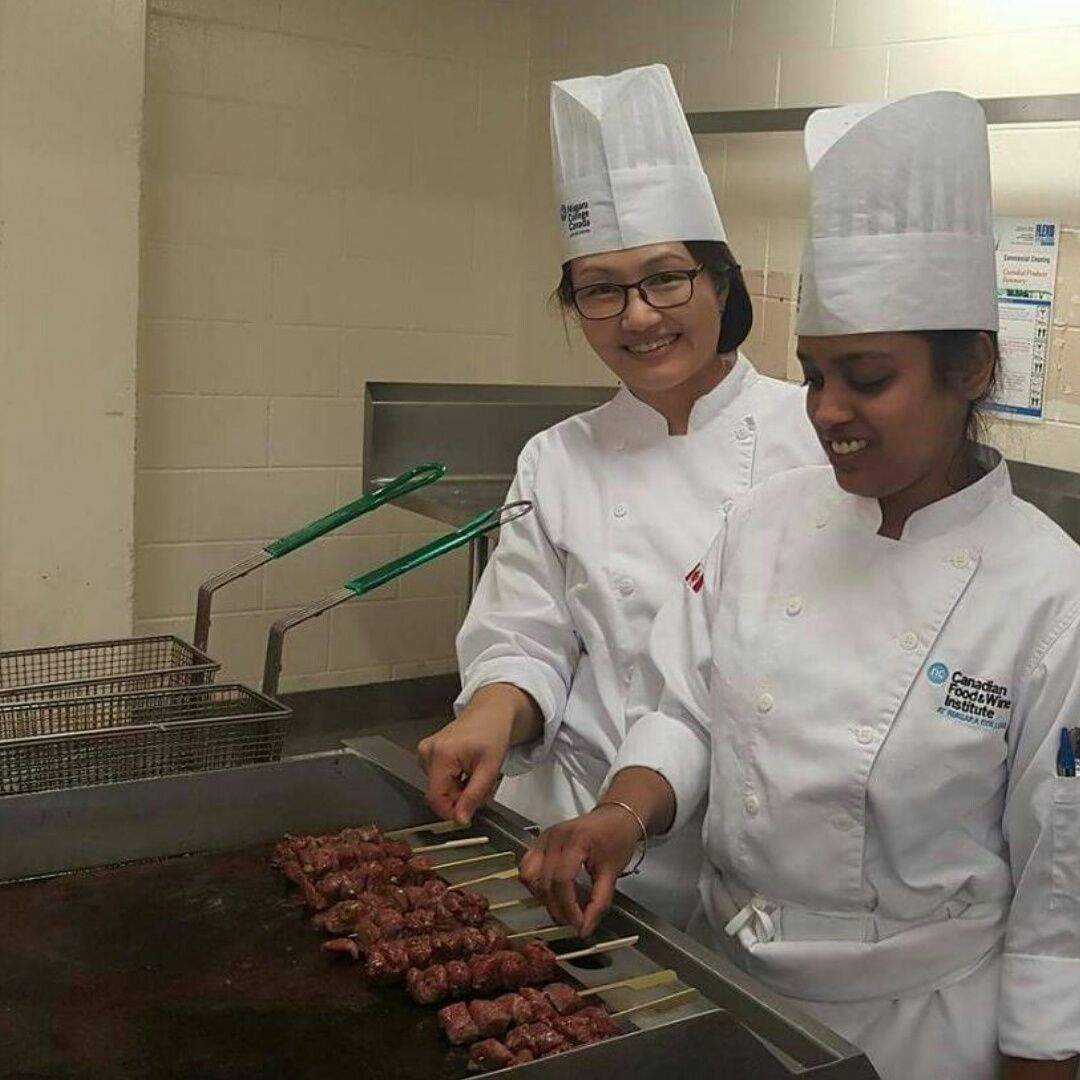 Cooking beef satay on skewers during lab how to cook