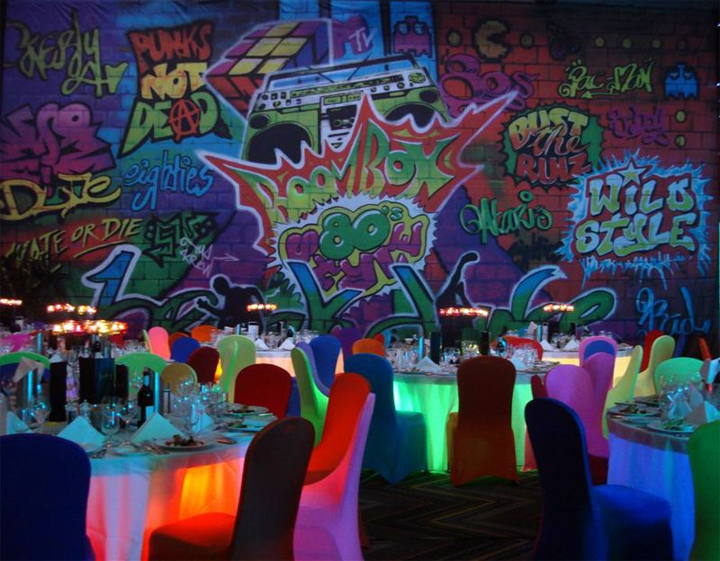 I love the lighted tables and the graffiti backdrops and for Old school party decorations