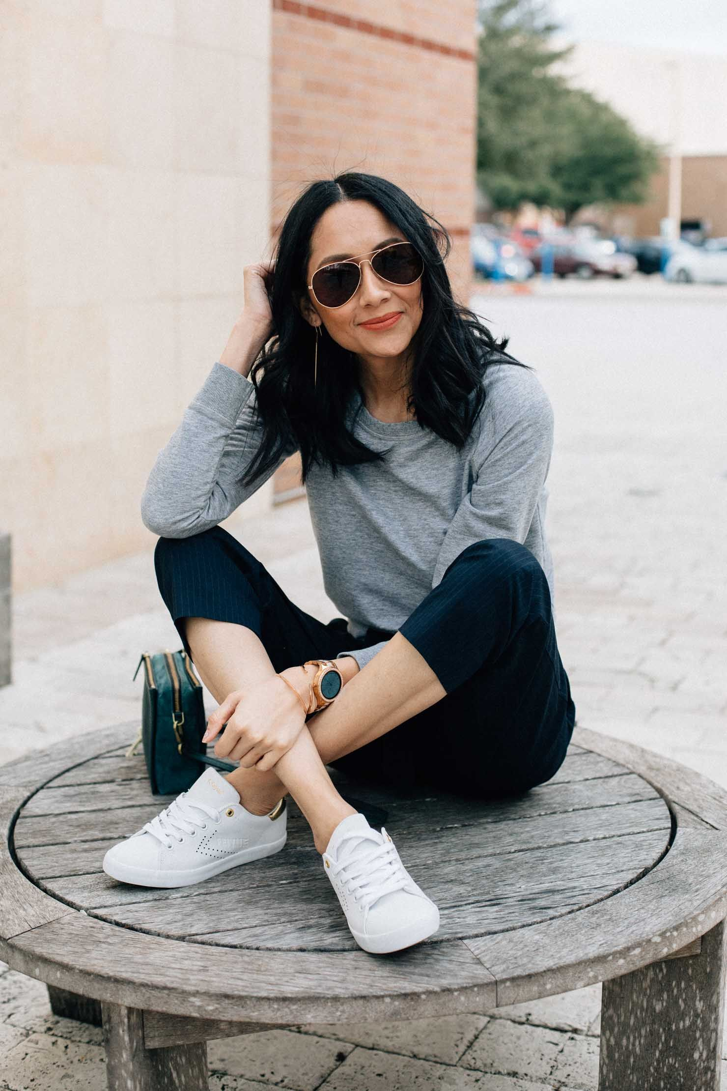 Fashion Blogger Lilly Beltran Wears Navy Slacks With A Grey Sweatshirt And White Sneakers For An Slacks For Women White Sneakers Outfit White Sneakers For Girl [ 2220 x 1480 Pixel ]