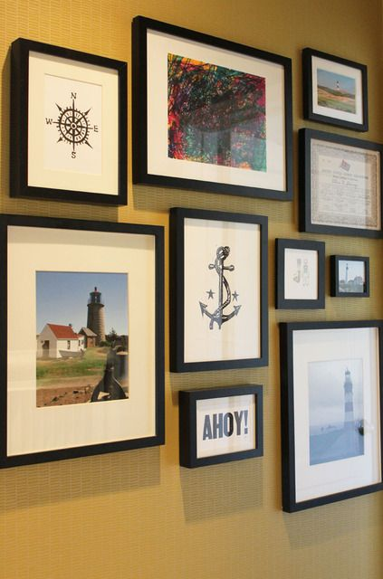 photo wall. like the mix of prints, photography and illustration.