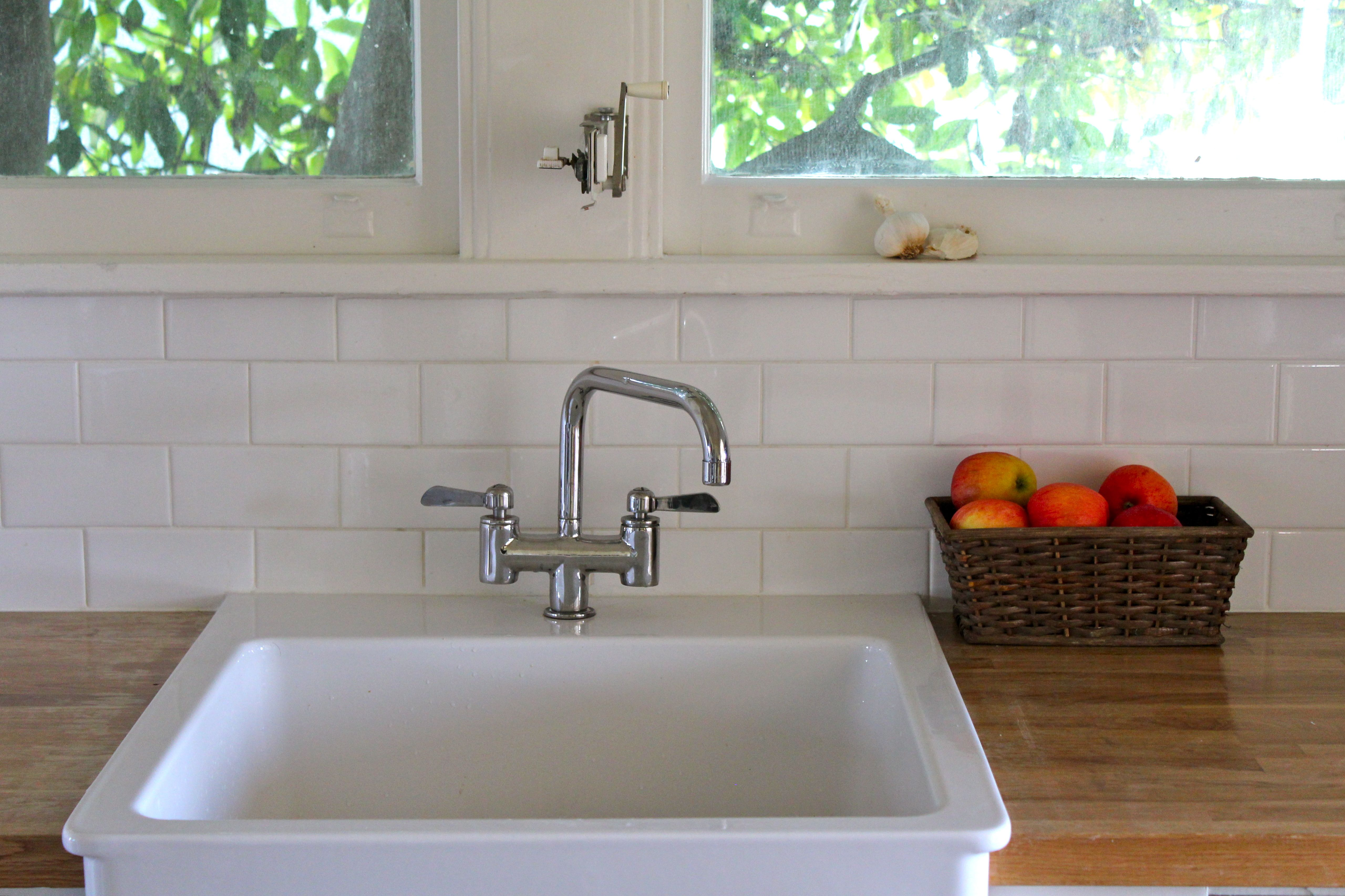 Subway Tile Backsplash Butcher S Block Counter And A Front Sink Le