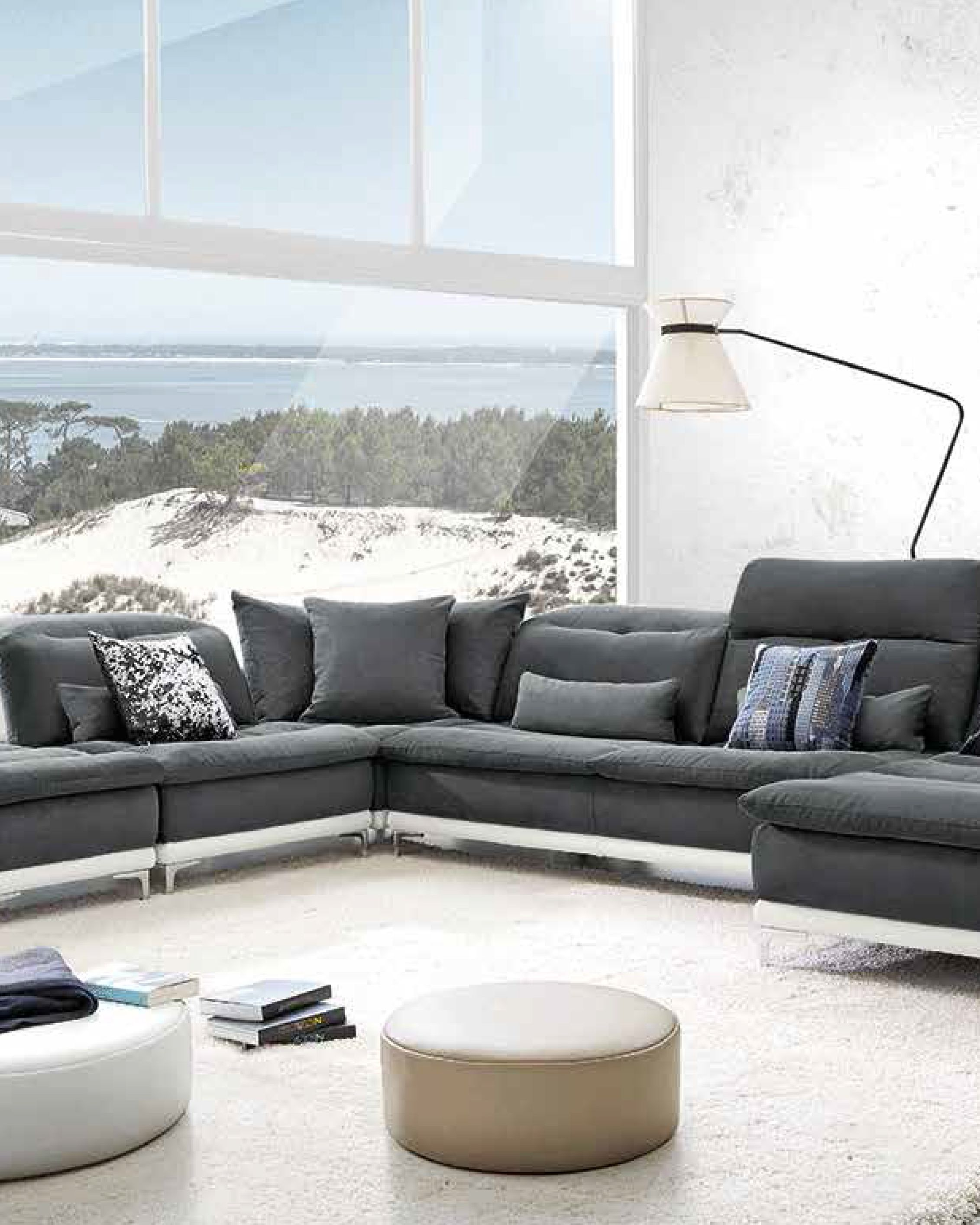 The Lusso Horizon Modern Grey & Leather Sectional Sofa brings in a commodious gentle feel featuring adjustable headrests and cushioned backs. Perfect for large and open spaces!