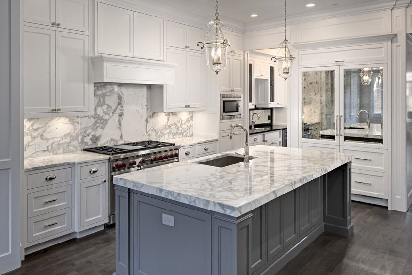 Bright White Kitchen With Carrara Marble Counters