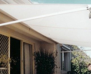 Designed to create shade and protection over doors, upper ...