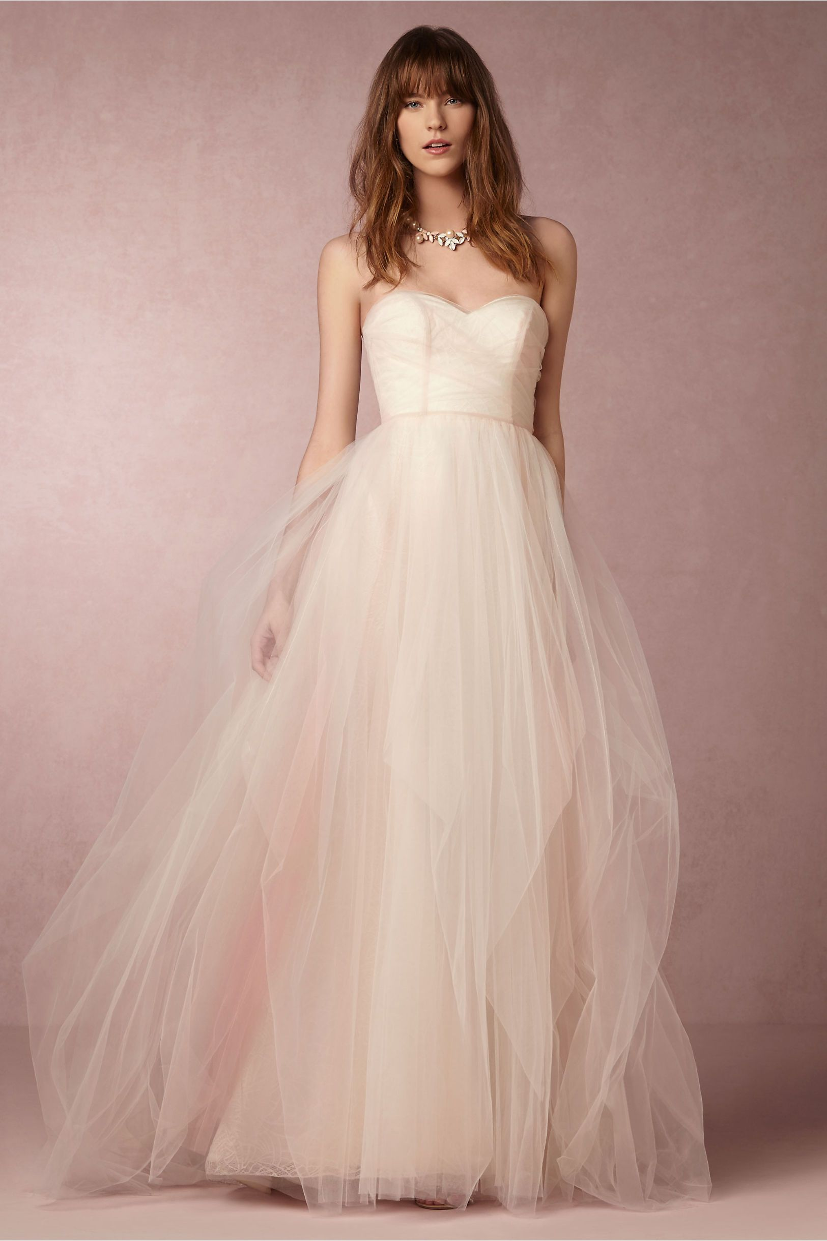 6567daf3cba Layered blush tulle creates an ombre-effect overdress