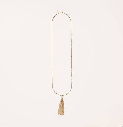 """We love the luxurious drape of this tassel-topped piece. Goldtone finish. Lobster claw clasp. 19"""" drop."""