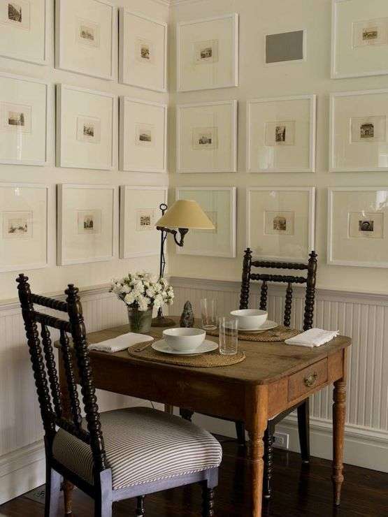 Phoebe Howard - Chic rustic dining space with white chair rail