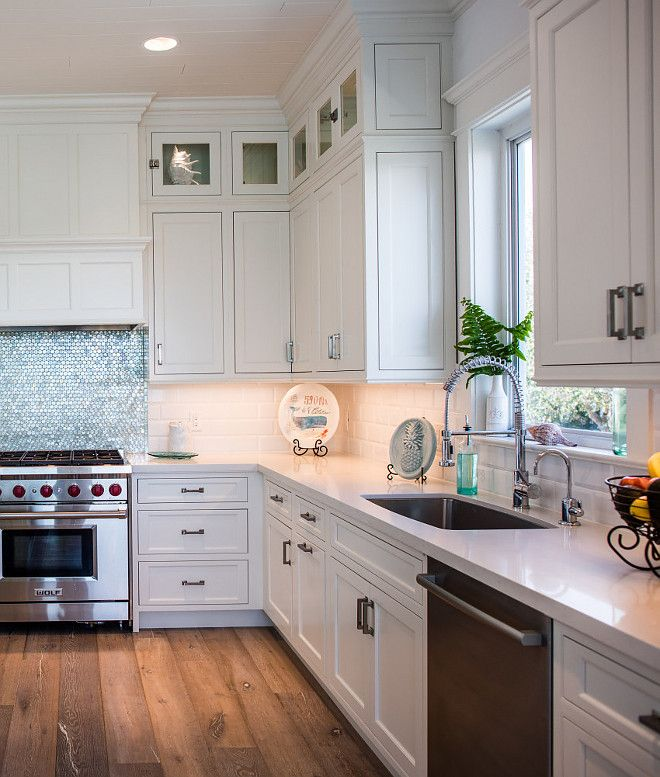 Kitchen Backsplash The white beveled subway tiles are Porcelanosa