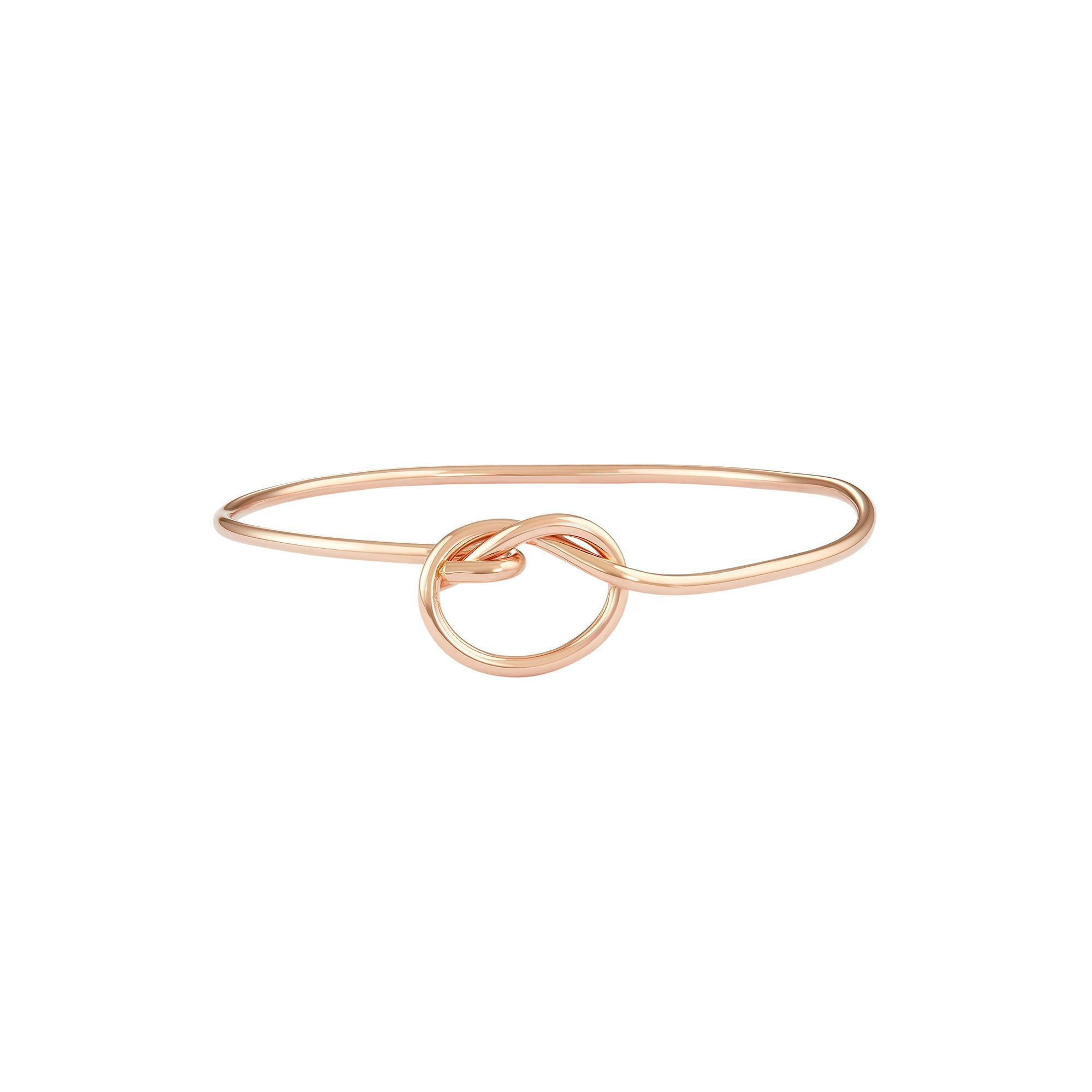 Journee collection sterling silver love knot bangle bracelet