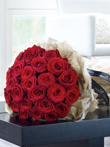 Featuring stunning grand prix roses with steel grass, expertly hand-tied and presented in luxurious packaging by Flowers.ie for maximum impact when your gift is delivered. order Flowers Ireland