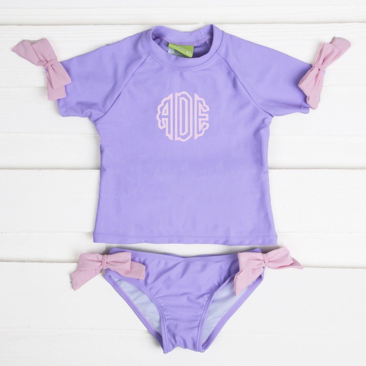 89a429dc87bc Bow Short Sleeve Rash Guard Lavender - Swimwear - Girls Smocked Auctions