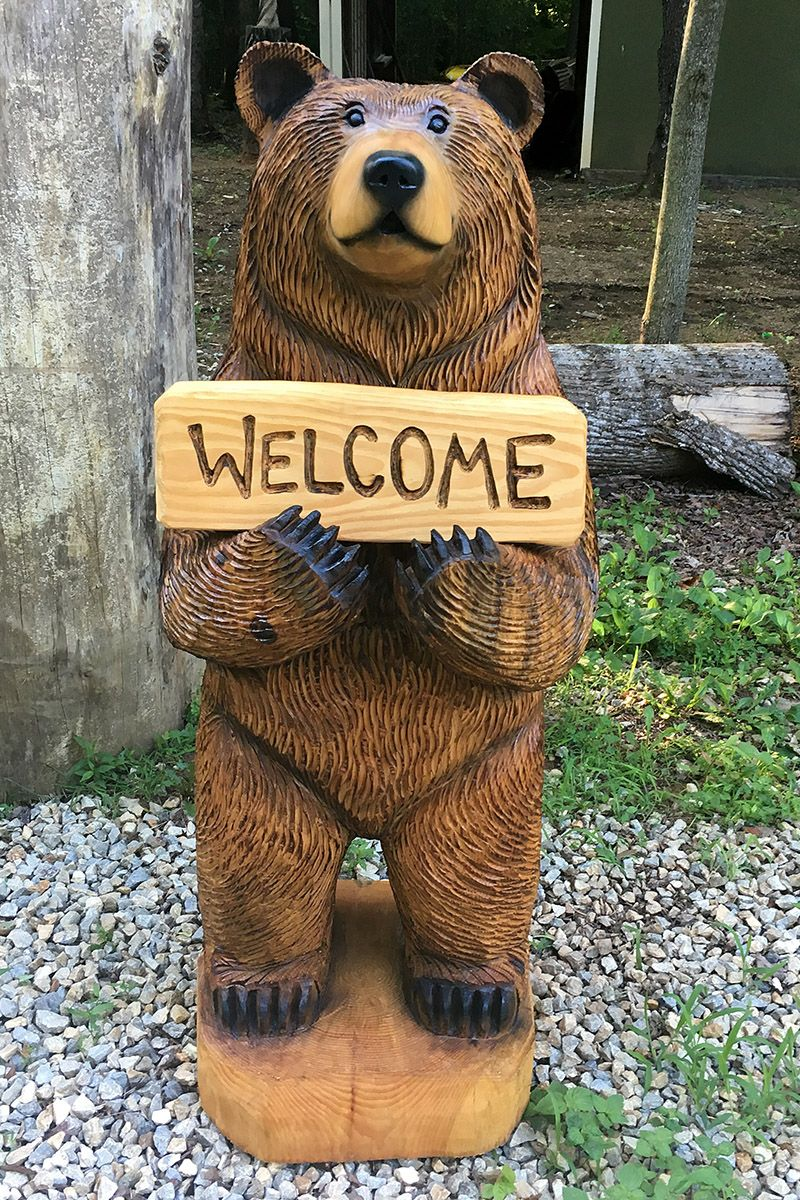 Big Brown Bear Holding A Welcome Sign With A Sweet Smile Wood