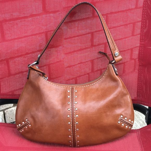 50873e7958f06 Michael Kors small studded brown leather hobo Fair condition Michael Kors  studded hobo bag. Does