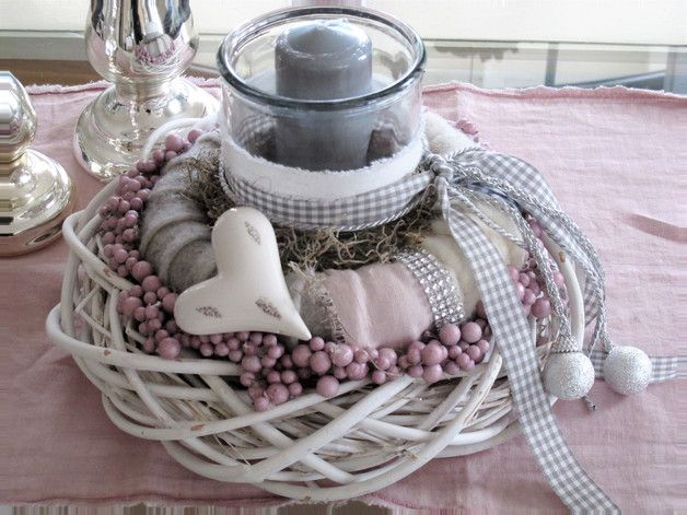 Photo of Modern table wreath made of white vine wreath with a shabby look and a light gray …
