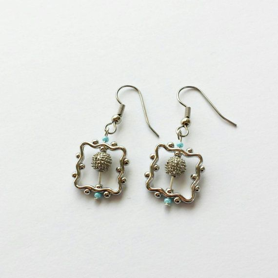 Check out this item in my Etsy shop https://www.etsy.com/listing/211330729/silver-earrings-with-blue-accents