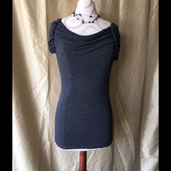 Adorable Shirt This is a really cute shirt. Has stretch to it, and is soft like a t-shirt. The sleeves are gathered and capped. Cute to dress up or down. Wrapper Tops Blouses