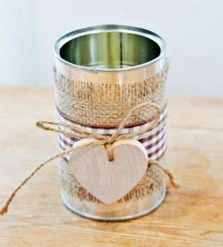 On a budget? Get creative and save money! Shown is a simple coffee can, wrapped in burlap with a pendant tied with twine. Designs such as these allow you to put your own personal stamp on your wedding.
