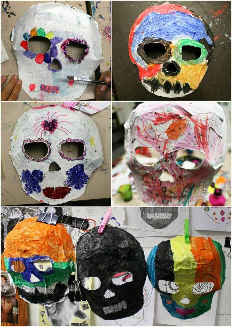 Totenkopf-Masken aus Pappmache von Kindern dekoriert | basteln ...