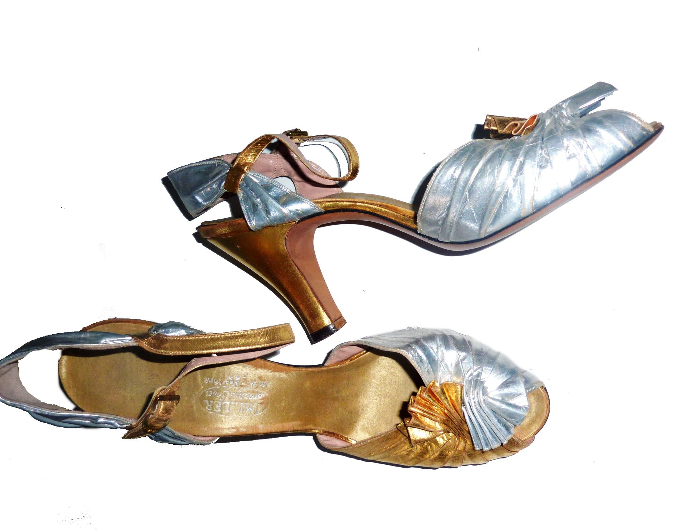 the 1930s and 1940s had a wonderful selection of both gold and silver leather pumps! Here is one of our examples!