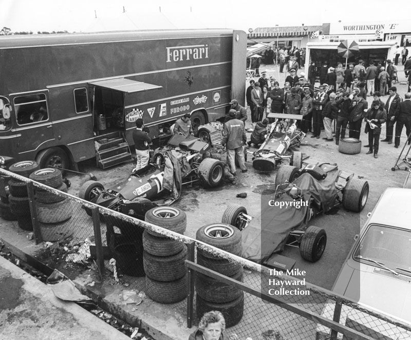 #Ferrari mechanics working on Chris Amon and Pedro Rodriguez's 312 V8's in the paddock, Silverstone, British Grand Prix 1969. #f1 #formula1