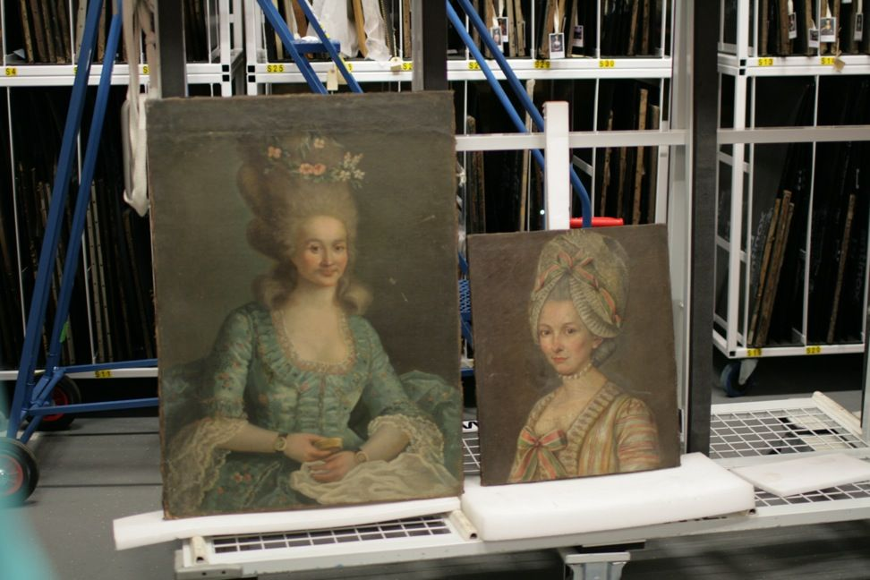 Two paintings of fashionable ladies waiting to be conserved in the picture store #BowesMuseumLates