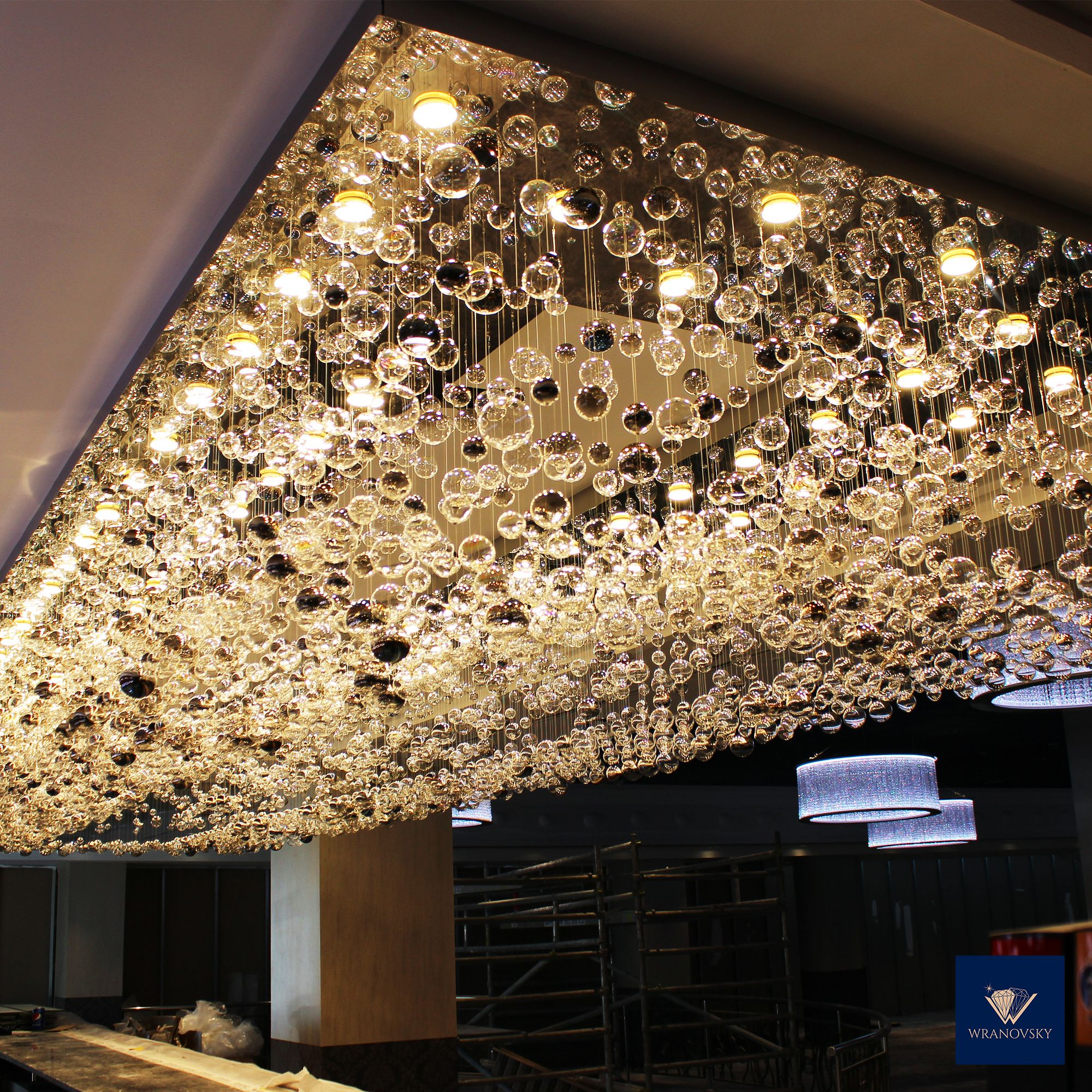 We Have Recently Installed Large Modern Bespoke Chandeliers From Hand Blown Crystal Bubbles In A Casino In Spai Chandelier Crystal Chandelier Modern Chandelier