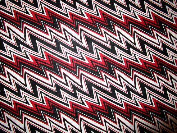 One yard+ beautiful heirloom quality premium Blank Quilting fabric. Red, White and Black Zig-Zag perfect for your next quilt! I have more of