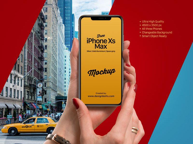 FreeGirlHoldingAppleiPhoneXsMaxMockupPSD2018