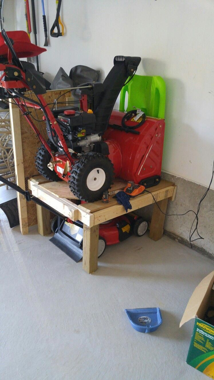 Space Saver For Garage Lawn Mower And Snow Blower On Top Garageremodeling With Images Diy Garage Storage Garage Shelving Lawn Tool Storage