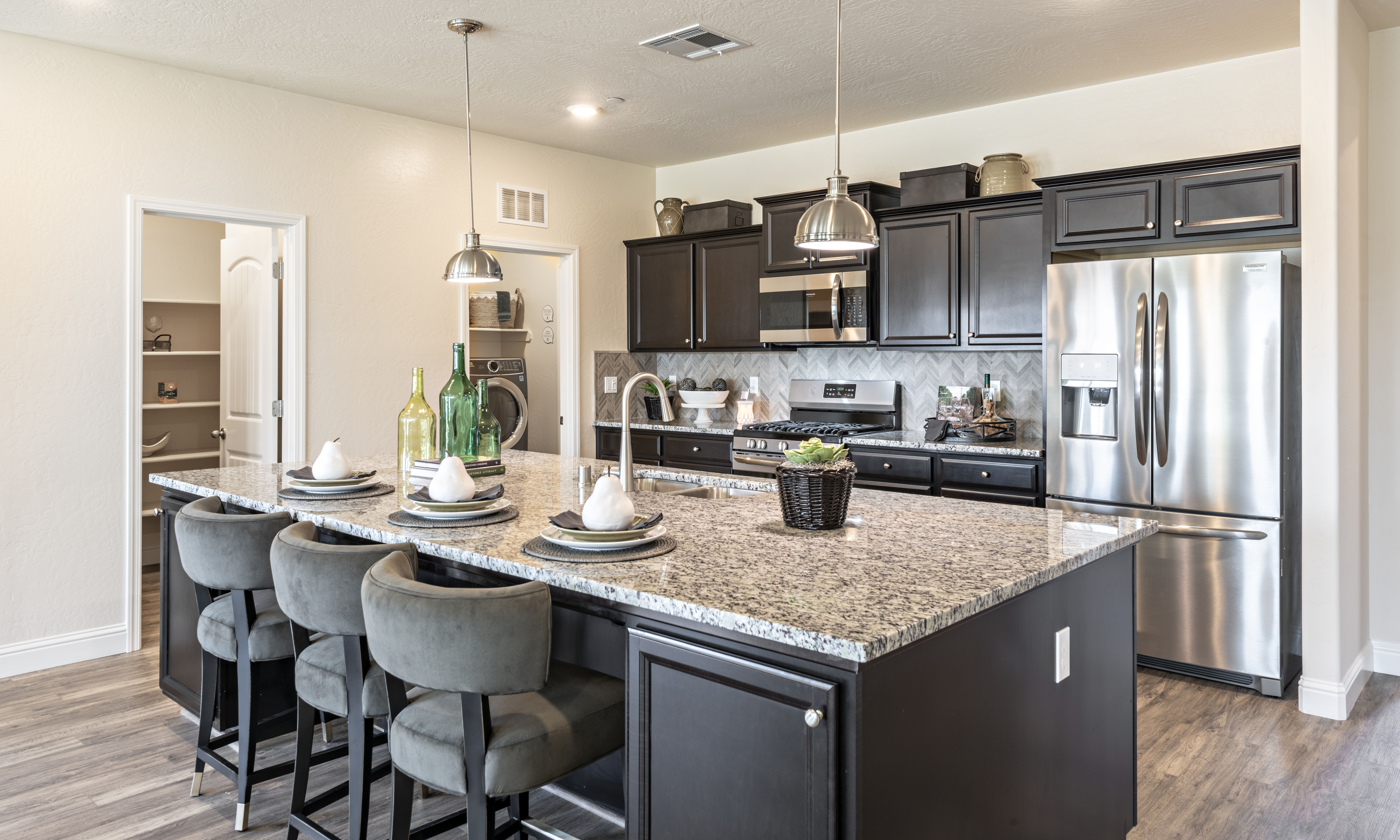 Dark Wood Kitchen Cabinets With Granite Counter Tops And Herringbone Backsplash Modern Bold In 2020 Kitchen Tops Granite New Homes For Sale Dark Wood Kitchen Cabinets