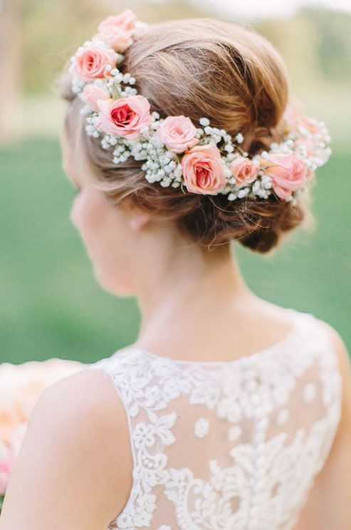 A pink floral crowns with soft baby's breath is incredibly romantic. #weddingflowers