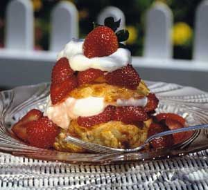 Pecans make this dessert of tender shortcake, freshly whipped cream, and sweetened berries sing. Make one large shortcake or 8 to 10 small cakes.