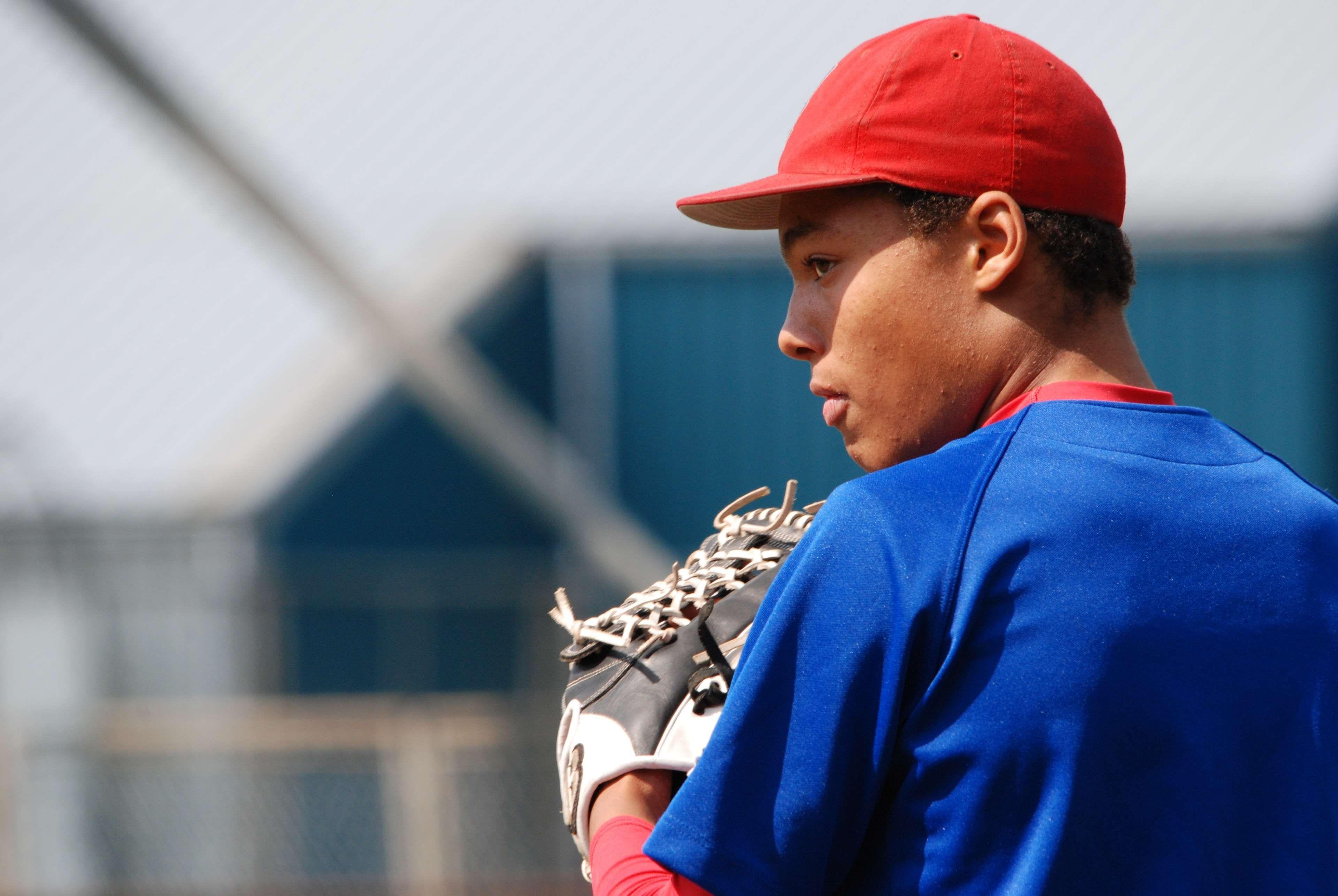 #athlete #baseball #baseball mitt #baseball player #blur #blurry #boy #close up #game #glove #guy #jersey #leisure #male #man #outdoors #pitcher #player #professional #recreation #sport #sports #staring #uniform