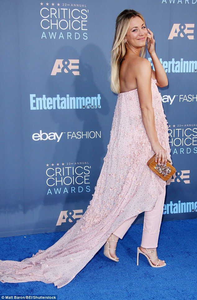Who made Kaley Cuocos pink strapless top, jewelry, and