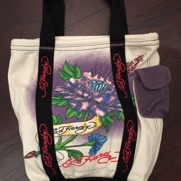 Ed Hardy canvas tote bag flowers and diamond This Ed Hardy tote has never been used its clean in and out in new to excellent condition two pockets inside and one has a zipper. A blue pocket outside can be used for a cellphone. There is a red tie which you can tie to close the two sides of the tote together  this kana very colorful and heavy duty canvas which is strong enough  to carry  a lot of weight if need to Ed Hardy Bags Totes