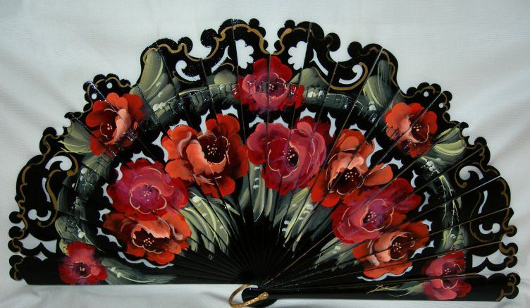 Black stunning unique collector Spanish Fan created exclusively for Lands Far Away, with finest quality Pear Tree Wood. All carved and painted by hand with gorgeous red flowers.