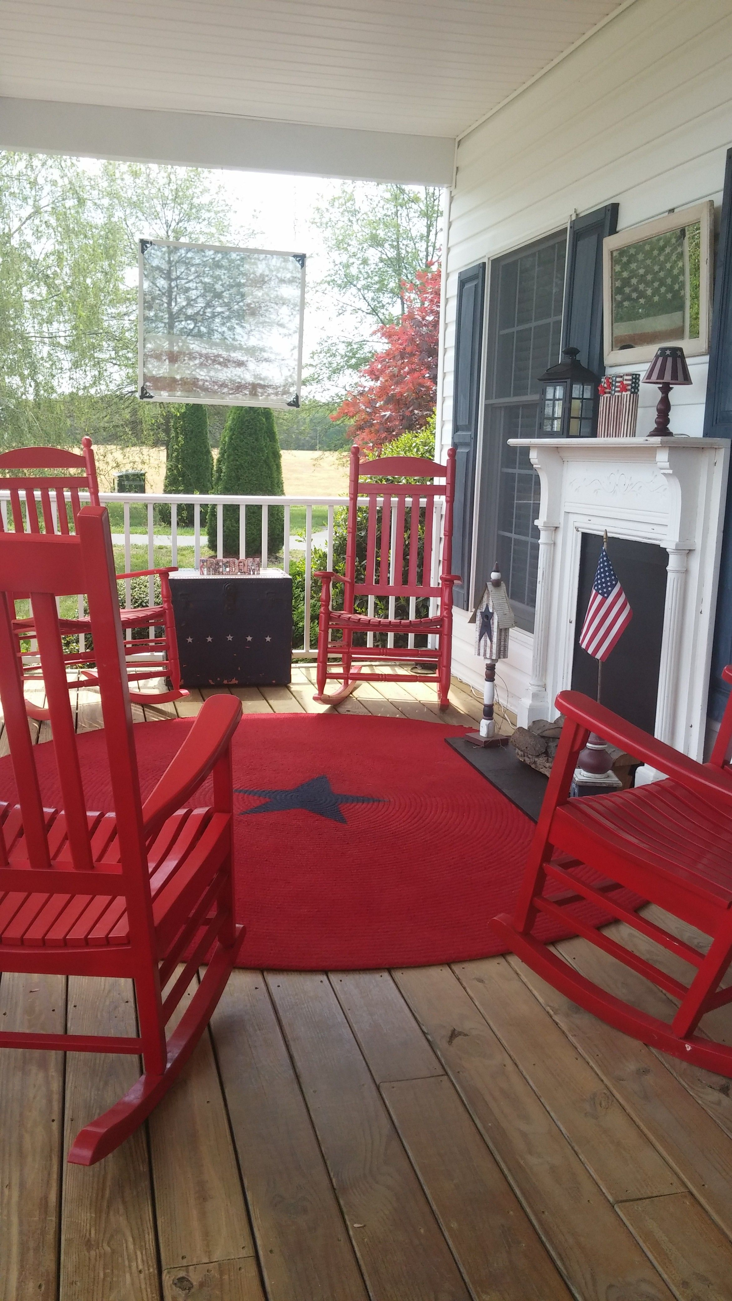 A Daylight View Of An Americana Front Porch With A Faux Fireplace Faux Fireplace Front Landscaping Porch