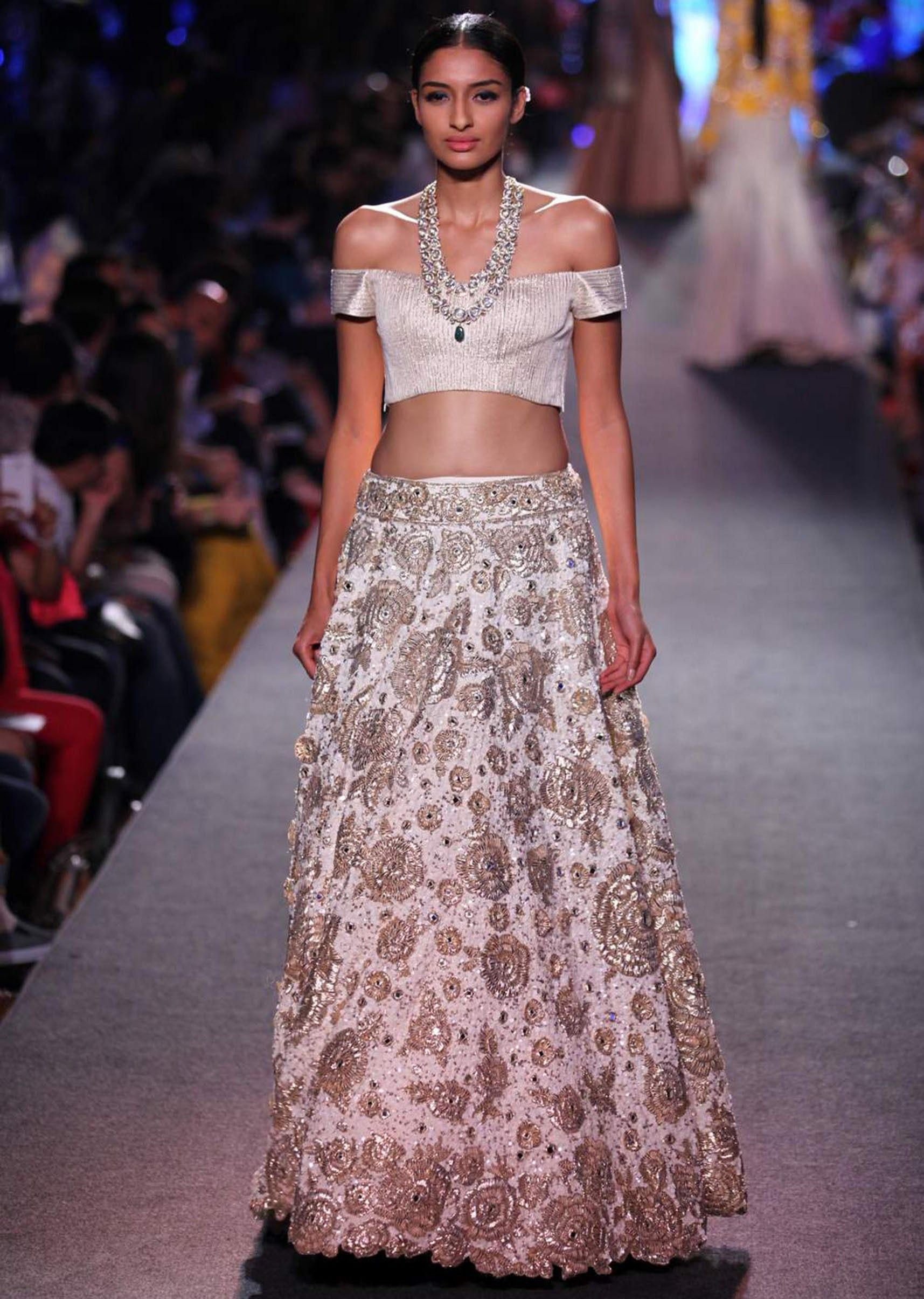 00e83a5e8fee Model walks the ramp in cream lehenga with off shoulder blouse for Manish  Malhotra Blue Runway collection at Lakme Fashion Week Summer Resort 2015
