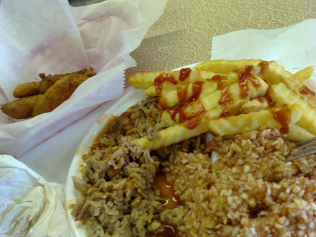 a typical bbq plate hushpuppies bbq bbq slaw and fries from